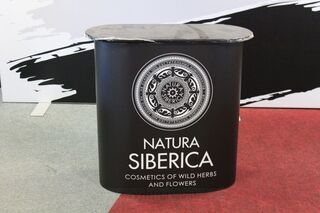 Exhibition table with Natura Siberica logo